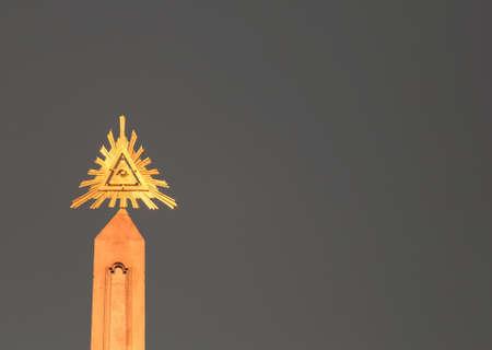 golden symbol of eye of providence on grey background