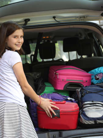 cute little girl before the travel with many luggages before the travel