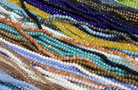 many necklaces of precious colored pearls for sale in a jewelry store