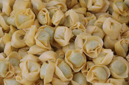 background of many italian pasta called Tortellini filling with with fresh spinach and pecorino cheese Stock Photo
