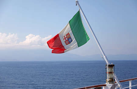 Italian flag on the big ship with symbols of Maritime Italian Republic