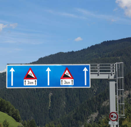 two big road signs with very steep road and danger of overheating of vehicle brakes