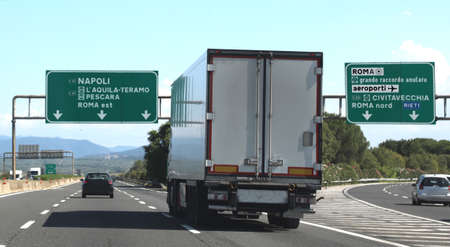 junction motorway with truck and italian traffic signal near Rome City