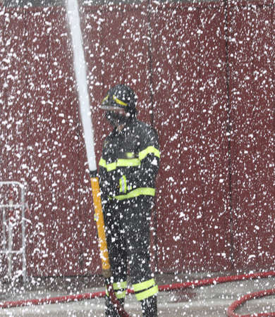 fire fighter uses foam like snow during fire