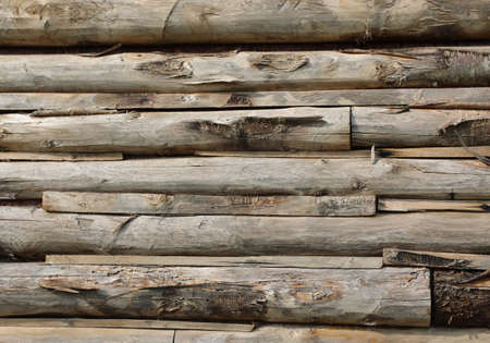 many wooden boards of a wall of an hut in mountain