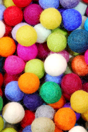 background of felt balls for sale as christmas ornaments