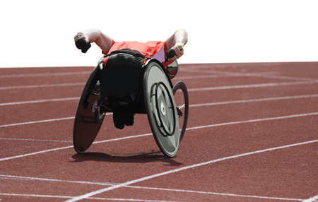 athlete on special wheelchair on the running track during the sport race on white background Stockfoto