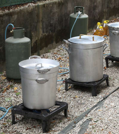 cookhouse with big pots and fire with gas