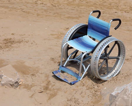 wheelchair with big wheel in alluminium on the sandy beach Reklamní fotografie