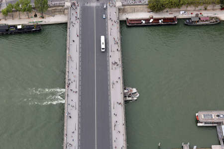 Long bridge called Pont Iena in french language in Paris from Eiffel Tower and the Seine River Editorial