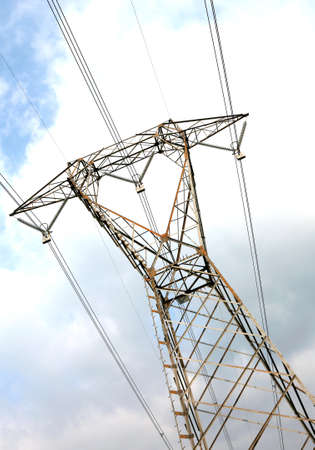 high voltage pylon with  electric wires and blue sky on background purposely inclined Stok Fotoğraf