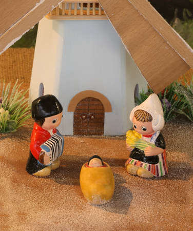 Dutch nativity scene with Holland windmill and baby Jesus Stock Photo