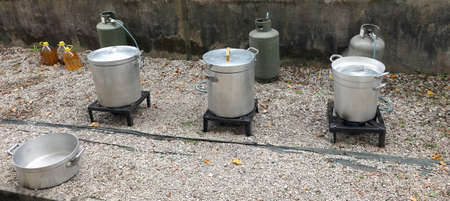 big pots on the outdoor kitchen and the gas cylinders