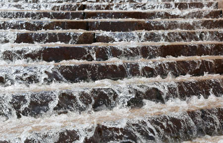 steps of a big stairway with water during flooding