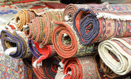 many rugs and carpets at stand of the market Standard-Bild
