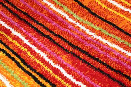detail of a background of a carpet with oblique colored lines