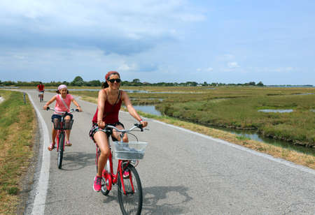 family with mother and daughter on the bikes in summer Standard-Bild