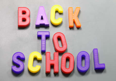 magnetized letters with text Back to School at blackboard