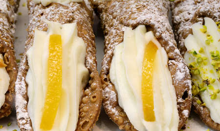 Cannolo is a typical cake of Sicily in Italy with candied orange fruit