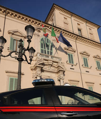 Rome, RM, Italy - March 3, 2019: car of Italian police called Carabinieri with sirens near the Qurinal Palace and the flags Sajtókép