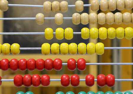 beads of a vintage wooden abacus in the classroom of a school