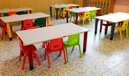 nursery school refectory without children with colorful chairs and small tables