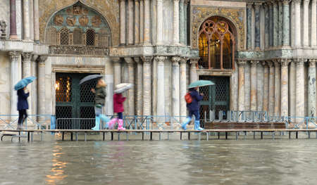 walkway in front of Basilica of Saint Mark in Venice Italy during the high water