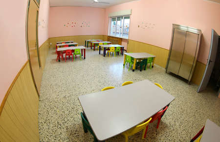 lunchroom with chairs and low tables for a school for the children without kids