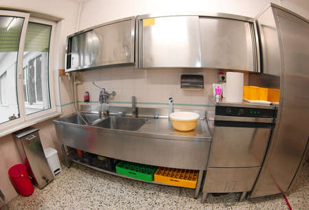 wide kitchen in stainless steel without people