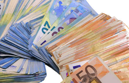 heap of many european money in twenty and fifty banknotes on a white background