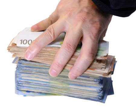 hand of a man grabbing a huge pile of european money banknotes on a white background