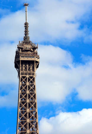 detail of the tip of the Eiffel Tower that soars in the Paris France