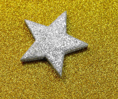 one big Silver Star on the glitter golden background Reklamní fotografie