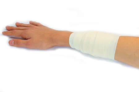 arm bandage of a boy after forearm burn on white background