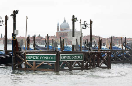 Boat called Gondolas and the text SERVIZIO GONDOLE that means GONDOLAS SERVICE in Venice in Italy without people Imagens