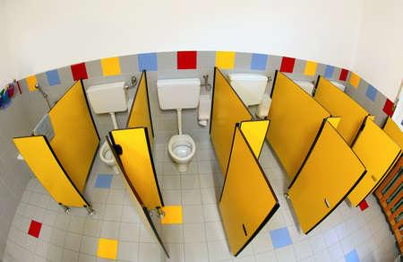 yellow doors on the bathroom of a kindergarten without children