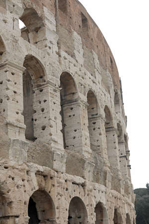 detail of the imposing Colosseum in Rome Capital of Italy and the holes made to recover the iron used during the construction of the monument 版權商用圖片