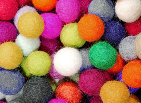 background of many colored balls made of felt that can be used to decorate the house