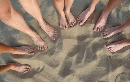 ten feet of family  on the sandy beach in summer
