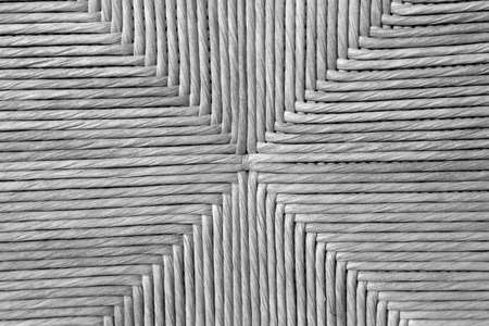 detail of the straw weave of an ancient chair handmade by the craftsman repairer of chairs Banque d'images
