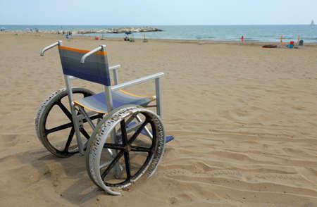 empty aluminum wheelchair on the beach