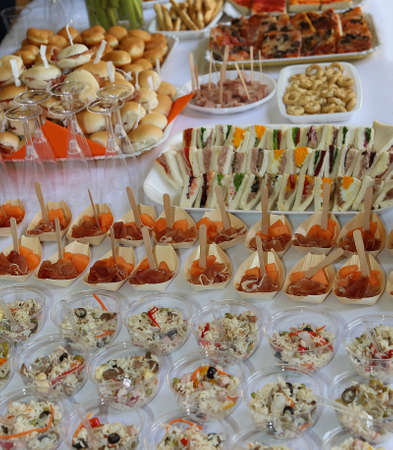 many sandwiches stuffed with salads during the wedding reception party Standard-Bild