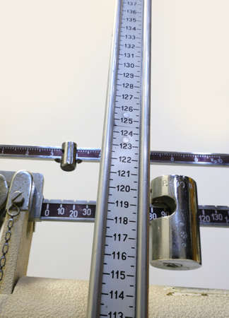 ancient bathroom scale with the graduated scale to also measure the height during medical visits in the pediatric surgery