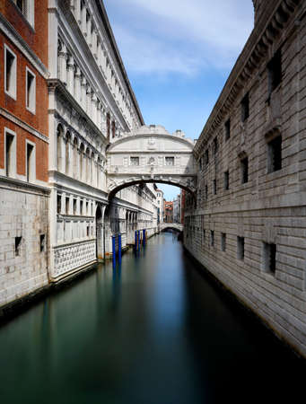 famous Bridge of sighs in Venice Italy photographed with the long exposure technique that makes the water appear immobile and static