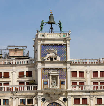 Bell Tower with statues called Due Mori in Venice in Italy and winged lion symbol of the Island