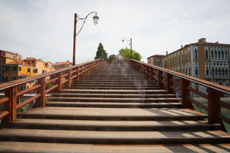 Bridge made of wood called ACCADEMIA which means of the University of the Island of Venice in Italy with the trail left by people in motion