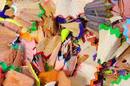woody shavings of colored pencils usable as a background for school activities