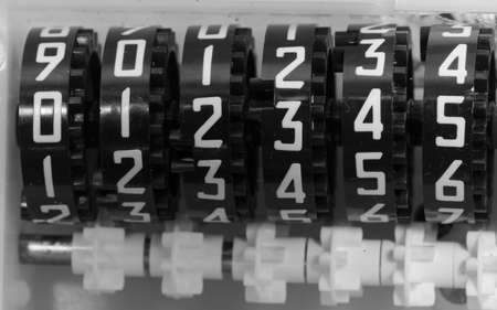 Numbers with gears of an analog meter to measure the electricity consumed by the user