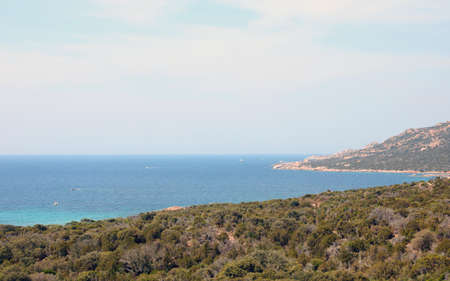Panoramic view with blue water of the gulf and the hill