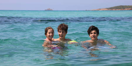 Three brothers on the sea in summer